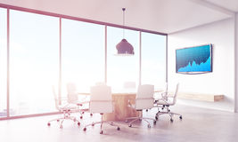 Trading company office interior. Broker's office with conference table and blue graph on lcd screen on wall. Panoramic window. Concept of trading and financial Royalty Free Stock Photos