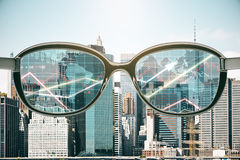Trading concept. Close up of abstract glasses with forex chart view on city background. Trading concept. 3D Rendering Stock Images