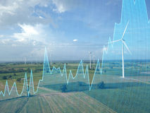 Trading graph on Wind turbine power generator, Business financia. L concept Stock Photos