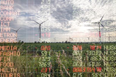 Trading graph on Wind turbine power generator, Business financia. L concept Stock Image