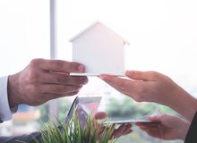 Trading home for cash home loan and buying concept. Trading home for cash for home loan and buying concept stock photo