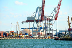 Trading port with cranes Royalty Free Stock Photos