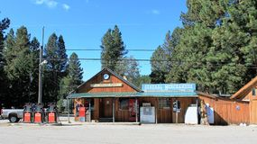The Trading Post at Tulameen BC. General store and gas station at the rural community of Tulameen.  Natural wood siding, red gas pumps, and Coco-Cola machine Royalty Free Stock Image