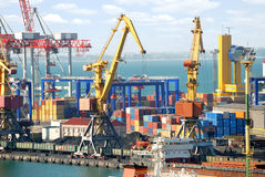 The trading seaport with cranes, cargoes and ship Royalty Free Stock Photos