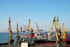 The trading seaport with cranes, cargoes and ship Royalty Free Stock Images