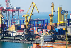 The trading seaport with cranes, cargoes and ship Stock Image