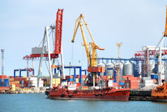 The trading seaport with cranes, cargoes and ship Stock Photos