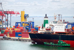 The trading seaport with cranes, cargoes and ship Royalty Free Stock Image