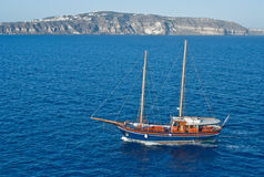 Trading ship. Blue trading two masted ship off Santorini Royalty Free Stock Image