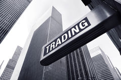 Trading. Sign in front of office buildings Royalty Free Stock Images