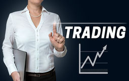 Trading touchscreen is operated by businesswoman.  Royalty Free Stock Photos