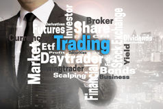 Trading wordcloud touchscreen is shown by businessman royalty free stock images