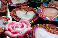 Tradional indian diya and wax rose. Tradional earthenware lamps (diya) hand made and decorated. Wax rose candle in the center Stock Photos
