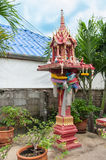 Tradional Thai Spirit house in backyrd of home Royalty Free Stock Image