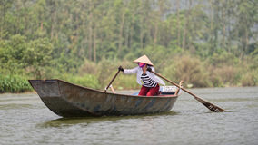 Traditional Vietnamese boat. A traditional Vietnamese boat in the water near the Perfume Pagoda in Vietnam Stock Image
