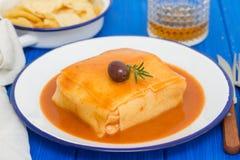 Tradirional portuguese dish francesinha on dish Stock Photography