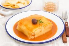 Tradirional portuguese dish francesinha on dish Stock Image