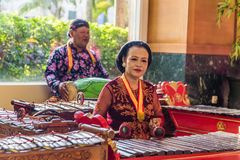 Traditiional music player in Indonesia. Jakarta, Indonesia - November, 02, 2017 Couple playing music on tradiitonal Indonesian instruments Stock Photo