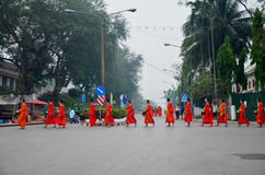 Tradition of almsgiving with sticky rice by Monks procession wal Stock Image