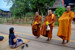 Tradition of almsgiving with sticky rice by Monks procession Stock Photo