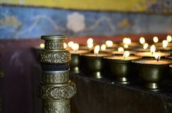 Tradition. Butter lamps being offered at a monastery Stock Images