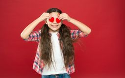 Tradition celebrate valentines day. Sincere love. Be my valentine. Family love. Girl cute child with hearts. Kid girl. With long hair red background. Celebrate stock photos
