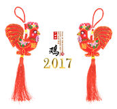 Tradition Chinese knot: Cloth doll Rooster. Chinese calligraphy Translation: year of the Rooster,Red stamps which Translation: good bless for new year Royalty Free Stock Photography