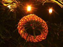 Tradition Christmas ring decoration made from dry straw. Christmas tree with small gentle lights. Stock Photography