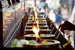 Tradition and culture of thailand, Thai people offering oil lamp Royalty Free Stock Images
