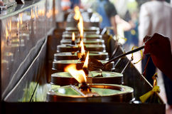 Tradition and culture of thailand, Thai people offering oil lamp Stock Photography