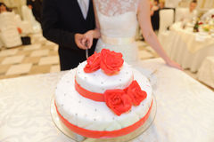 Tradition of Cutting Wedding Cake Stock Photo