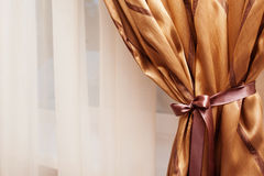 Tradition elegant background with curtain in the room gold color Stock Photo