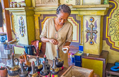 Tradition of Ethiopian coffee ceremony. KIEV, UKRAINE - JUNE 4, 2017: The young woman is the master of traditional Ethiopian coffee ceremony, she makes fresh Stock Image