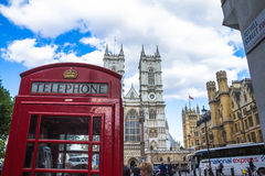 Tradition London red phone booth on University Church of St Peter background Royalty Free Stock Image