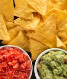 Tradition mexican guacamole and salsa dip, nachos tortilla chips. Tradition mexican guacamole and salsa dip, nachos tortilla chips, close-up royalty free stock photo