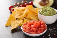 Tradition mexican guacamole and salsa dip, nachos tortilla chips. Tradition mexican guacamole and salsa dip, nachos tortilla chips, close-up stock photography
