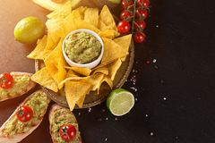 Tradition mexican guacamole and salsa dip, nachos tortilla chips. Tradition mexican guacamole and salsa dip, nachos tortilla chips, close-up royalty free stock image