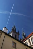 Tradition and modernity - the aspiration to the sky: Jet plane and the Catholic Cathedral. Stock Images