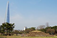 Tradition and modernity: Baekje grave sites in front of skyline, Seoul, Korea royalty free stock photo