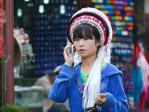 Tradition and modernity. Near Erhai lake, Dali is a traditional village of Yunnan province in China. Here, woman with traditional costume but cell phone Stock Image