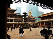 Tradition and modernity in Shanghai city, China. Religion and skyscrapers royalty free stock photos