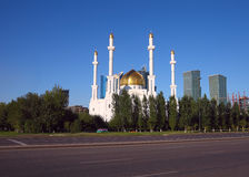 Tradition over modern. Mosque in downtown Astana. Stock Photo