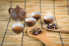 Tradition tea sets with herbs. On bamboo mat Stock Photos