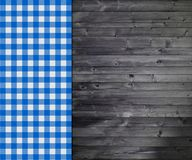 Tradition wooden background with blue tablecloth. Traditional rustic dark wooden background with blue and white tablecloth Royalty Free Stock Photos