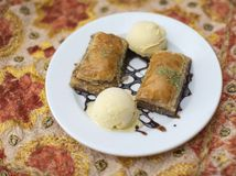 Traditiona indian dessert Baklawa. With ice cream scoop Stock Photos