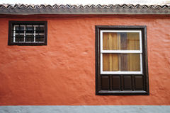 Traditional. Old wooden windows of orange facade royalty free stock photography