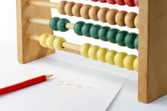 Traditional abacus with pencil and paper Stock Image