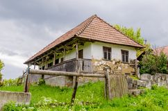 Traditional abandoned transylvanian adobe house. In a rural area with a sad degrading look Royalty Free Stock Photos