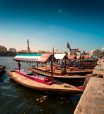 Traditional Abra taxi boats in Dubai creek - Deira, Dubai Deira, United Arab Emirates. Traditional Abra taxi boats in Dubai creek - Deira during sunny day, Dubai Stock Photos