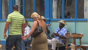 Traditional accoustic Cuban musicians entertaining touristst in Old Havana. stock video